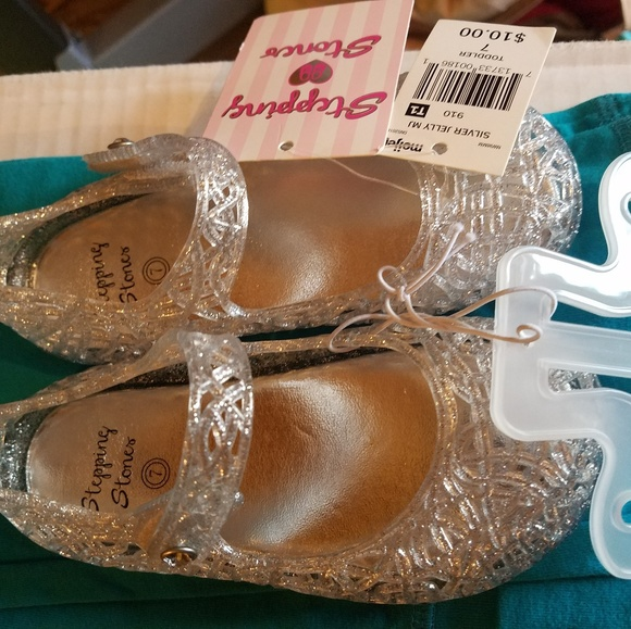 5aab4a963241 Silver sparkle jelly shoes. NWT. stepping stones